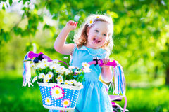 Little girl riding a bike Stock Photo