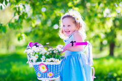 Little girl riding a bike Royalty Free Stock Photography