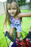 Little girl riding bike Royalty Free Stock Photos