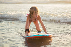 Little girl riding a boogie board Stock Photo