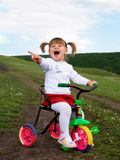 Little girl riding a bysicle stock images