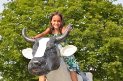 Little Girl Riding Cow Sculpture Royalty Free Stock Photography
