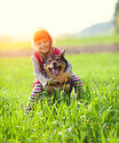 Little girl riding dog Stock Images