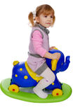 Little girl riding elephant toy Stock Photo