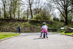 Little girl riding on her pink bike.  stock photo