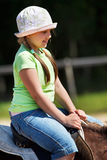 Little girl riding horse Royalty Free Stock Image