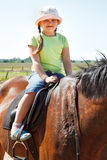 Little girl riding horse Royalty Free Stock Images