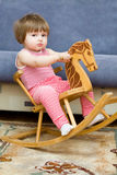 Little girl is riding horse Stock Photos