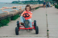 Little girl is riding on pedal karting. Stock Photography