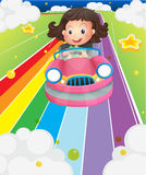A little girl riding in a pink car Royalty Free Stock Images