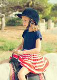 Little girl riding pony. Stock Photography