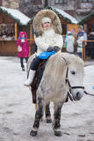 Little girl riding a pony Stock Photo