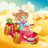 Little girl riding quad bike on desert Royalty Free Stock Image