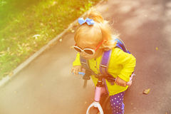 Little girl riding runbike outdoors Royalty Free Stock Photo