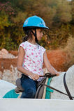 Little girl riding school Royalty Free Stock Photos