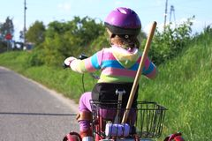 Little girl riding a three wheel bike Stock Photos