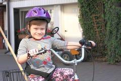 Little girl riding a three wheel bike Royalty Free Stock Photography