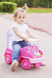 Little girl riding toy car Royalty Free Stock Photo