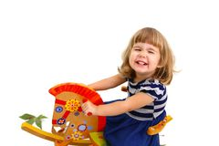 Little girl riding on toy horse isolated on white background Stock Photography