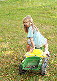 Little girl riding a tractor Royalty Free Stock Photography