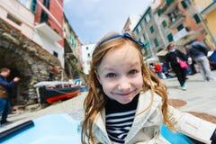 Little girl in Riomaggiore village in Cinque Terre Stock Images