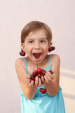 Little girl with ripe herries. Little girl with handful of cherries stock photography