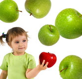 Little girl with ripe red apple Stock Images