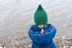 Little girl on a river bank Stock Photo
