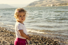 Little girl by river Stock Photo
