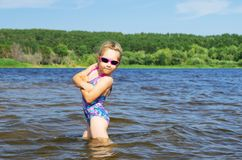 Little girl at river Stock Photo