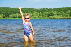 Little girl at river Royalty Free Stock Image