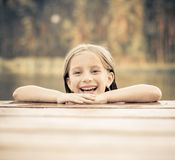 Little girl  in the river Stock Photos