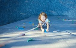 Little girl in  rock climbing gym Royalty Free Stock Image