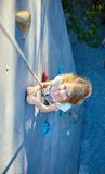 Little girl in  rock climbing gym Royalty Free Stock Images