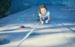 Little girl in  rock climbing gym Royalty Free Stock Photo