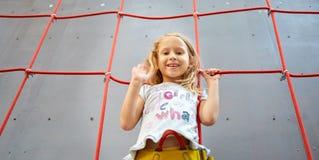 Little girl in  rock climbing gym Stock Photos