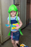 Little girl rock star in wig play guitar Royalty Free Stock Photo