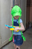 Little girl rock star in wig play guitar Royalty Free Stock Images