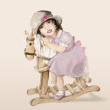 Little girl on a rocking horse Stock Image