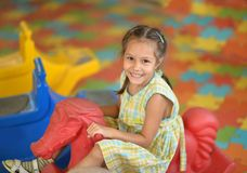 Little girl on  rocking horse. Stock Photo