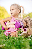 Little girl rocks to sleep the doll Stock Photo