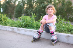 Little girl in roller seat Stock Images