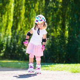 Little girl with roller skate shoes in a park Royalty Free Stock Photography