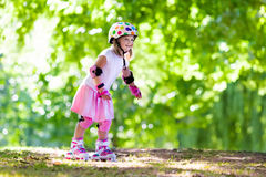Little girl with roller skate shoes in a park Stock Photos