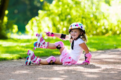 Little girl with roller skate shoes in a park Royalty Free Stock Photo