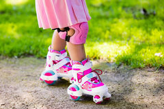 Little girl with roller skate shoes in a park Royalty Free Stock Image
