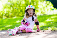 Little girl with roller skate shoes in a park Stock Photo