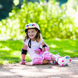 Little girl with roller skate shoes in a park Royalty Free Stock Images