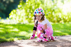 Little girl with roller skate shoes in a park Stock Photography