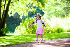 Little girl with roller skate shoes in a park Royalty Free Stock Photos